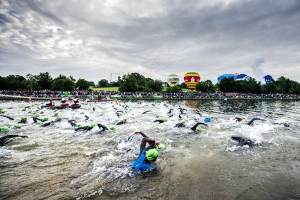 ROTH, GERMANY - JULY 17: (EDITOR'S NOTE: This image has been processed using digital filters) Athletes start the swim leg of the race during Challenge Triathlon Roth on July 17, 2016 in Roth, Germany. (Photo by Alex Caparros/Getty Images for Challenge)